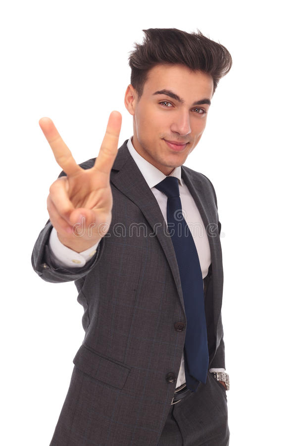 Happy business man making victory sign. On white background stock photo