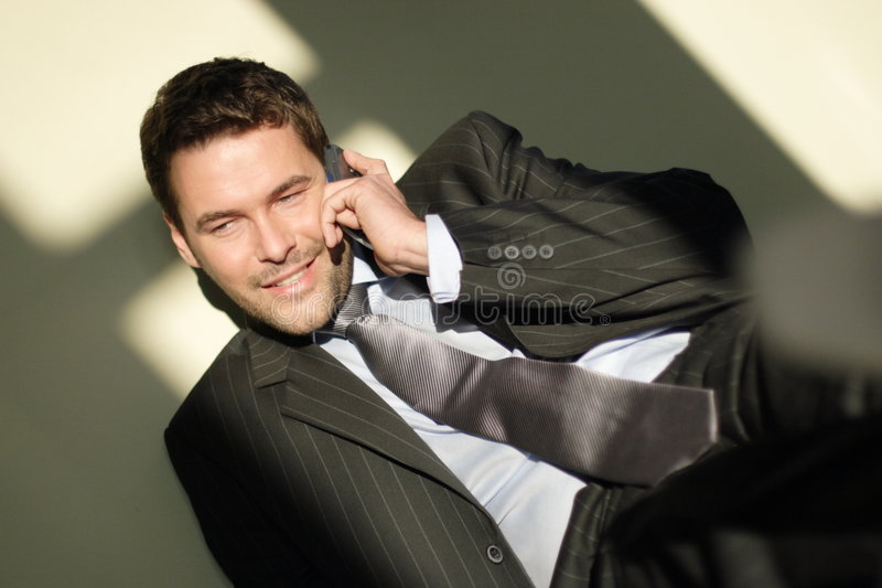 Happy business man on phone stock image