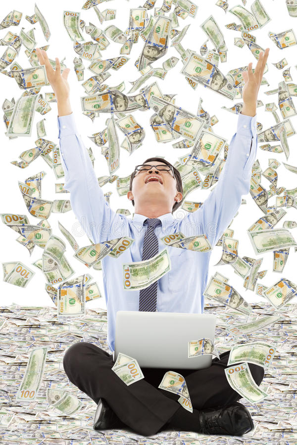 Happy business man raise hands to grab money. Over white background royalty free stock photo
