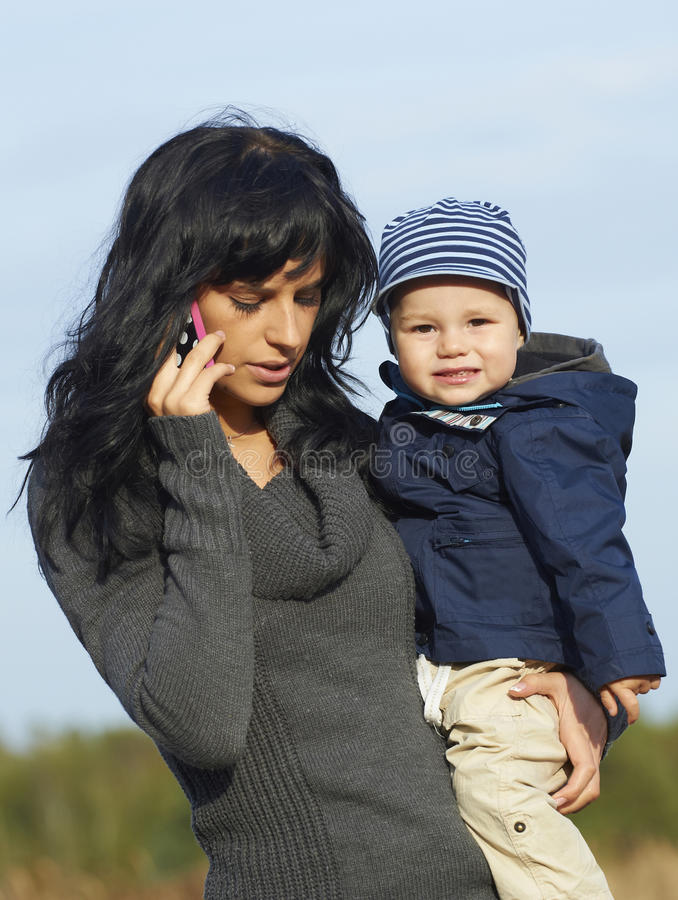 Free Happy Business Mother With Little Boy Royalty Free Stock Photo - 27040535