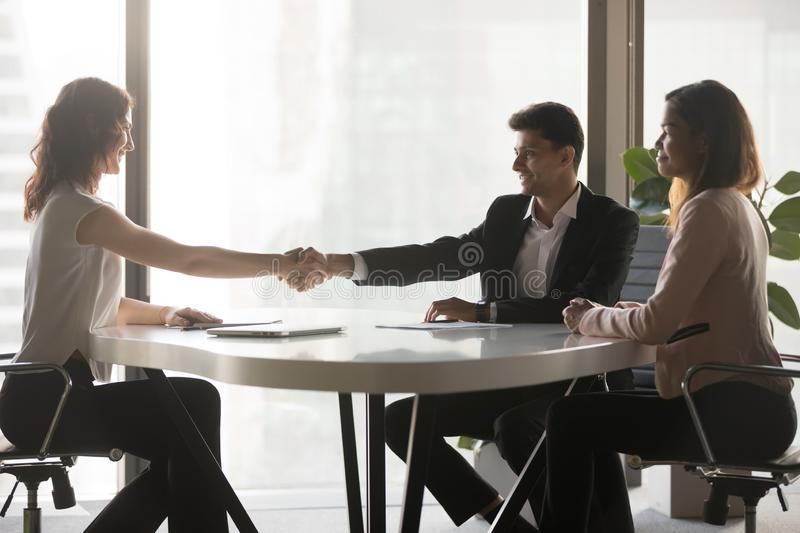 Happy business partners handshake closing deal in office royalty free stock images