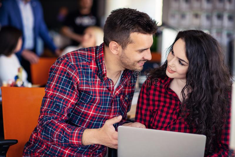 Happy business partners working on laptop. Teamwork, co-working concepts. stock images
