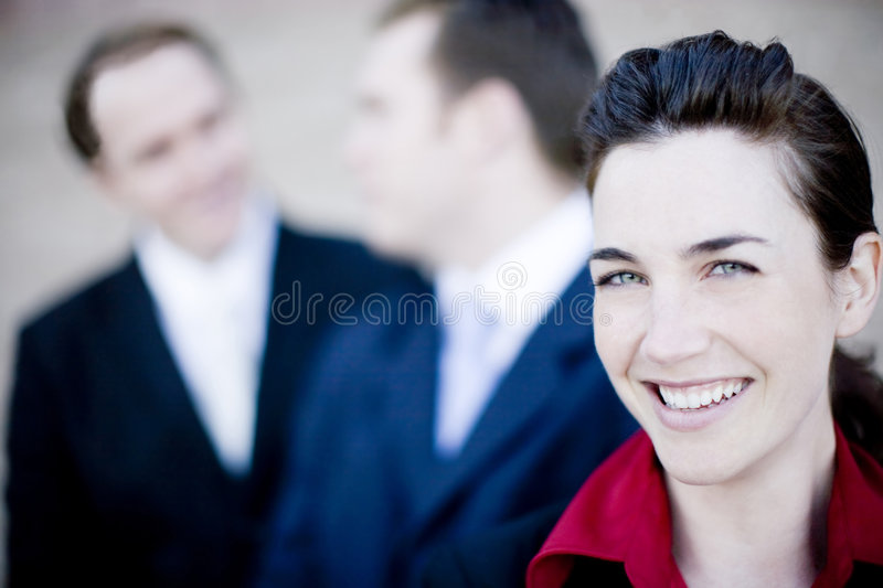 Happy business people. Close up of three attractive businesspeople smiling and talking stock images