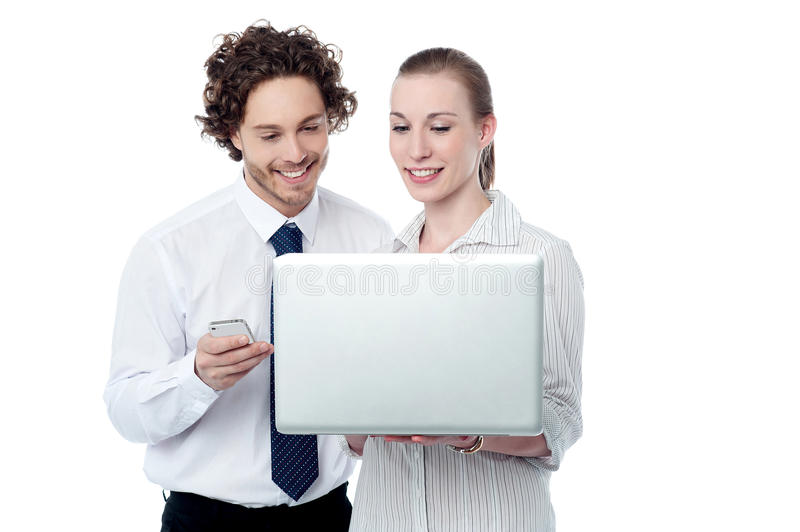 Happy business people browsing on a laptop. Corporate executives working in a laptop computer stock photo
