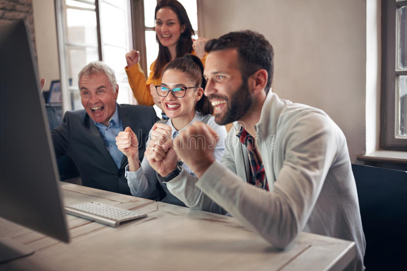 Happy business people celebrating successful projects stock photos