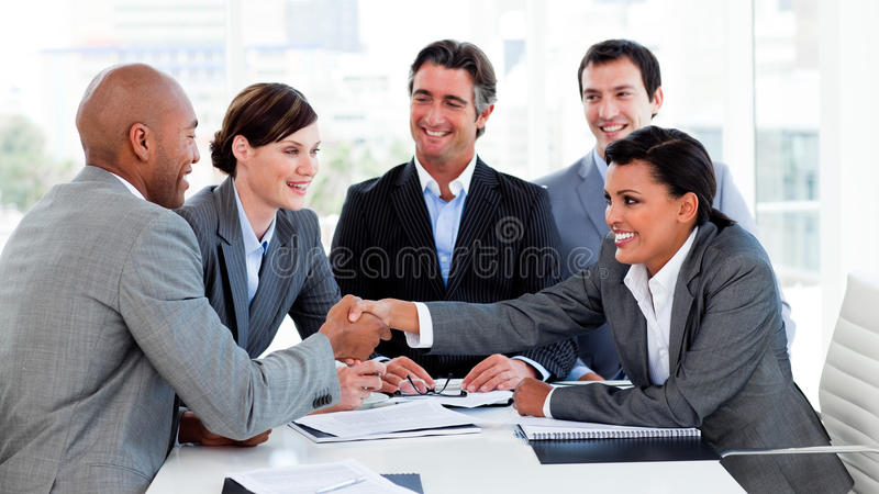 Happy Business People Closing A Deal Royalty Free Stock Photography