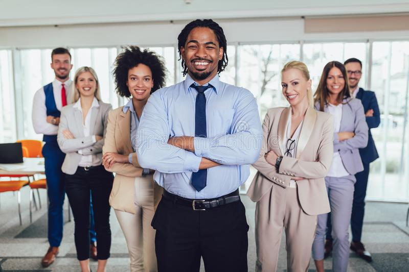 Happy business people and company staff in modern office, representig company.Selective focus royalty free stock image