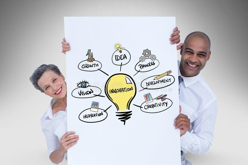 Happy business people holding card with illustration of innovation process stock photo