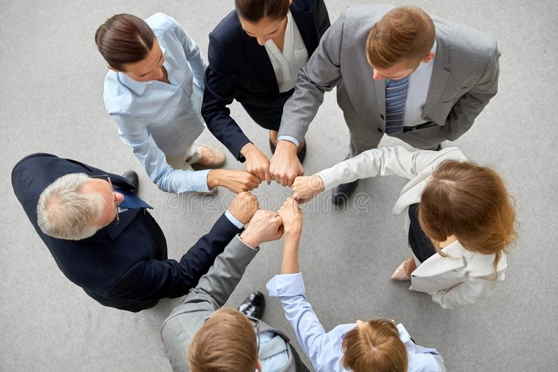 Happy business people making fist bump royalty free stock photos