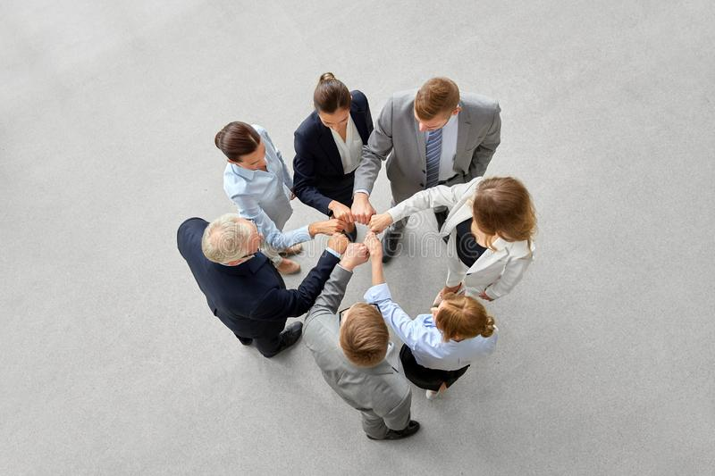 Happy business people making fist bump royalty free stock image
