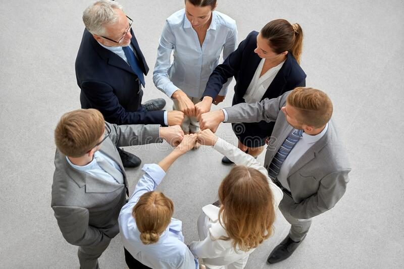 Happy business people making fist bump royalty free stock photo