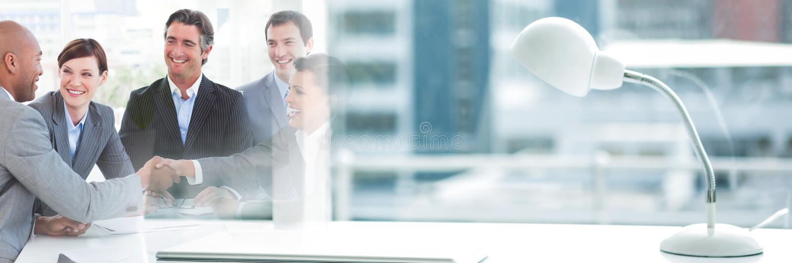 Happy business people shaking hands stock photos