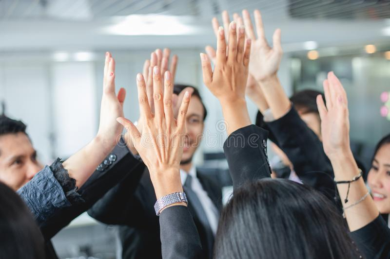 Happy Business people showing team work and giving five after signing agreement or contract with foreign partners in office royalty free stock photo