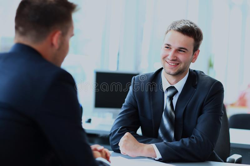 Happy business people talking on meeting at office. royalty free stock photo