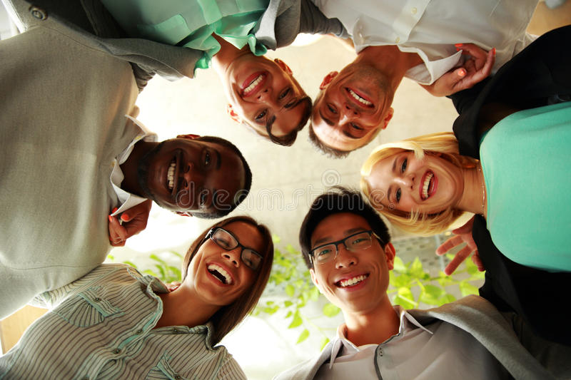 Happy business people with their heads together. Representing concept of ftiendship and teamwork stock photography
