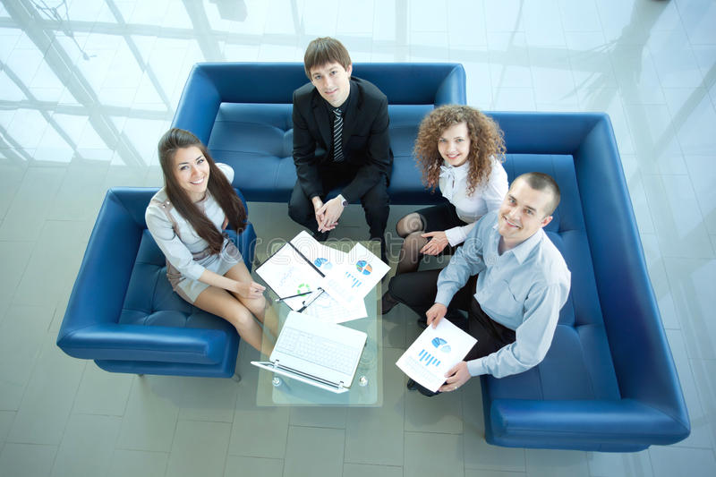Happy business people working. Top view of working business group sitting at table during corporate meeting royalty free stock photo