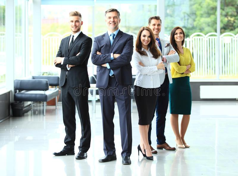 Happy business team with arms crossed at the office. royalty free stock photos