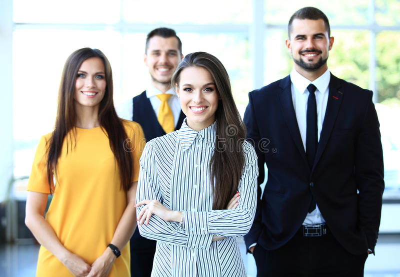 Happy business team with arms crossed at the stock photos