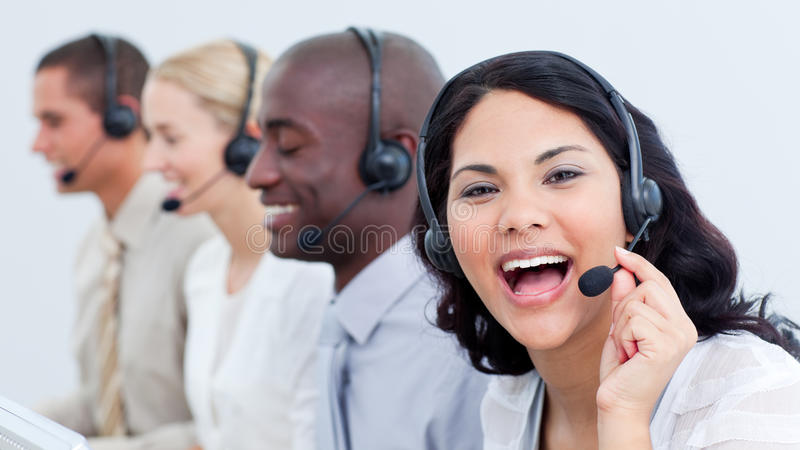 Happy business team in a call center royalty free stock photography