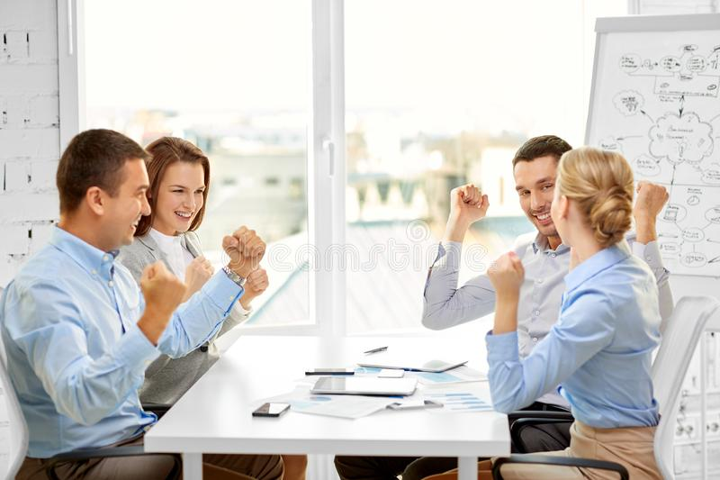 Happy business team celebrating seccess at office stock photo
