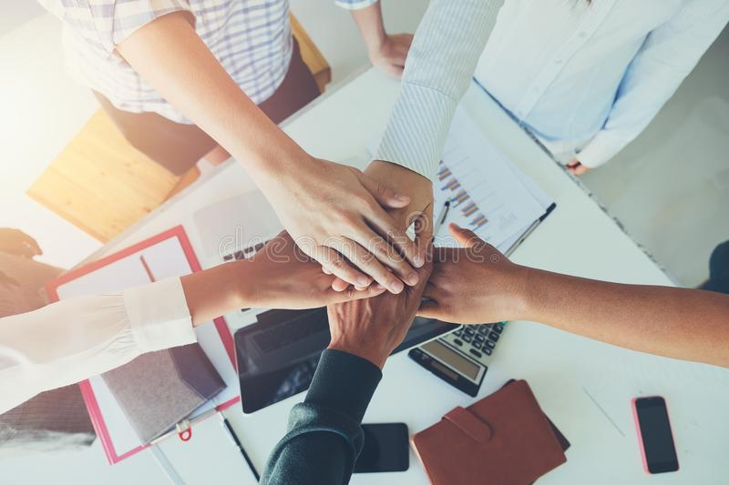Happy business team celebrating victory in office. Success concept.Top view royalty free stock image