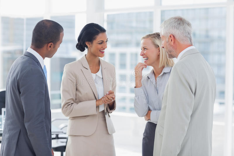Download Happy Business Team Chatting And Laughing Stock Image - Image of staff, happy: 32511091