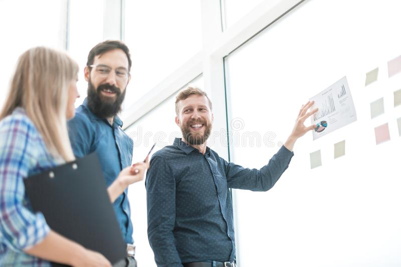 Happy business team discussing the results of a new financial project royalty free stock photography