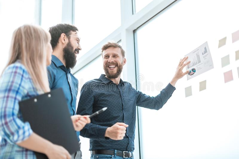 Happy business team discussing the results of a new financial project royalty free stock photo