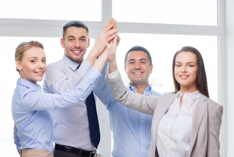 Download Happy Business Team Giving High Five In Office Stock Image - Image: 40041097