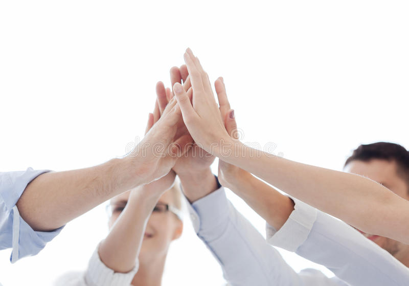 Happy business team giving high five in office royalty free stock photography