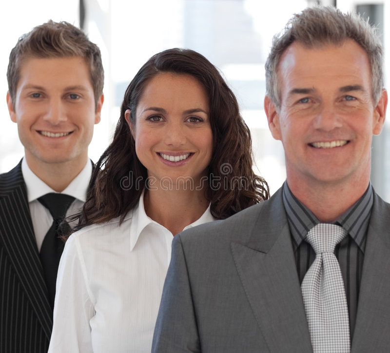 Happy Business team looking at camera stock photos