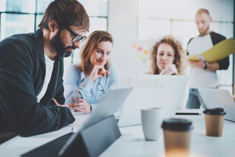 Happy business team making conversation at sunny meeting room.Horizontal.Blurred background. royalty free stock photo