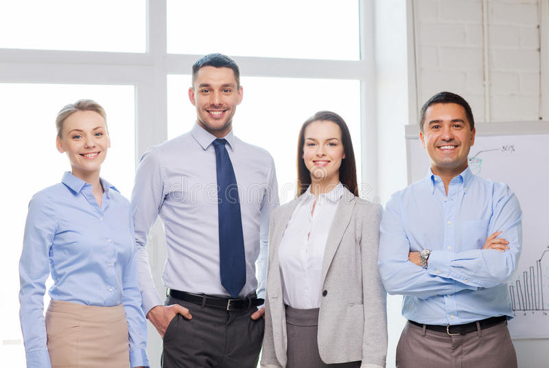 Happy business team in office stock photo