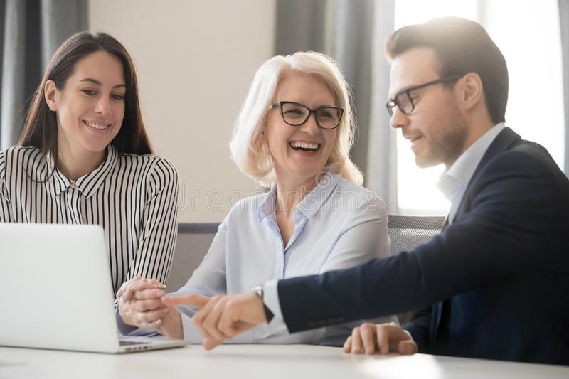 Happy business team people colleagues talking laughing working together stock photography