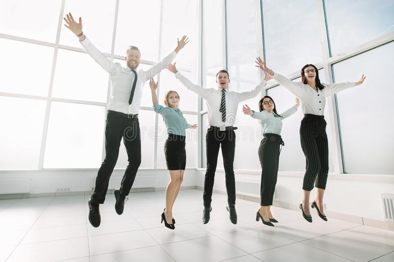 Happy business team, rejoicing in the spacious new office. stock photography