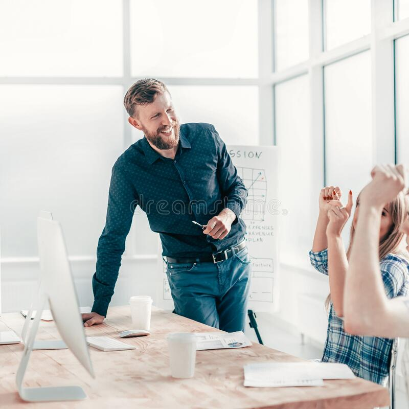 Happy business team at work meeting in office stock image