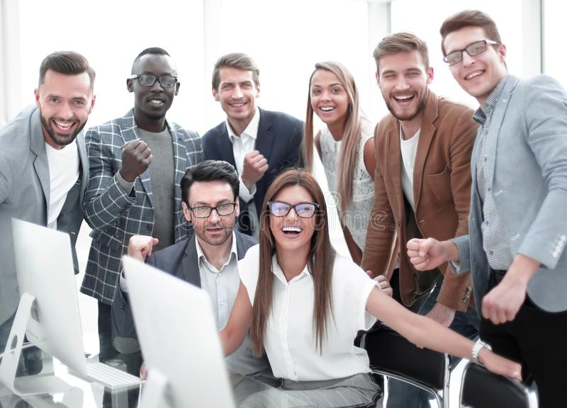 Happy business team in the workplace. stock photo
