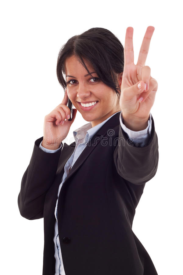Happy business woman. With phone and victory gesture, isolated royalty free stock photography