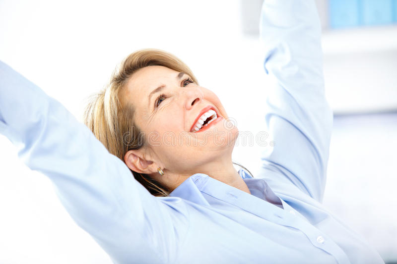Happy business woman. In the office stock images