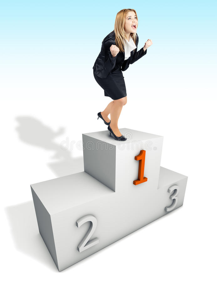 Happy business woman being the first place on podium stock photos