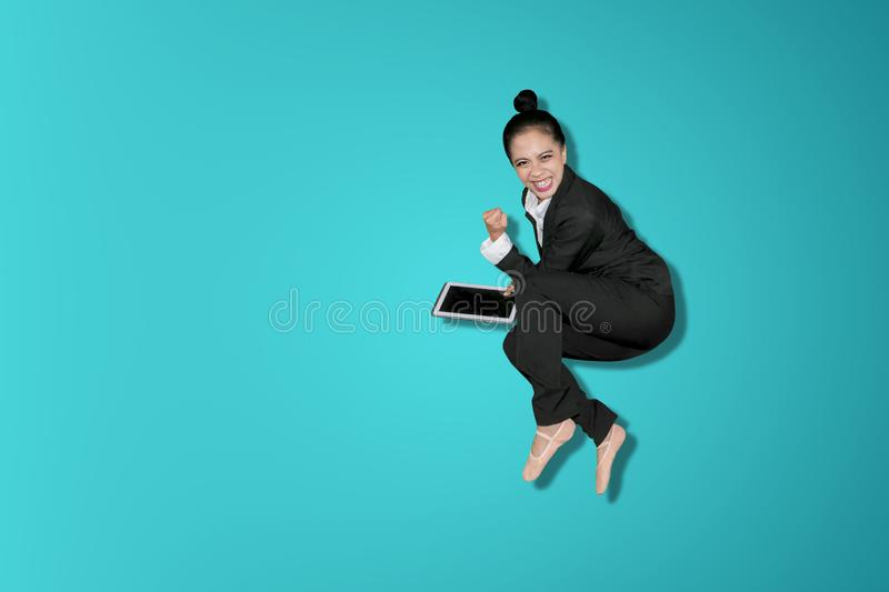 Happy business woman celebrates success by jump royalty free stock photos