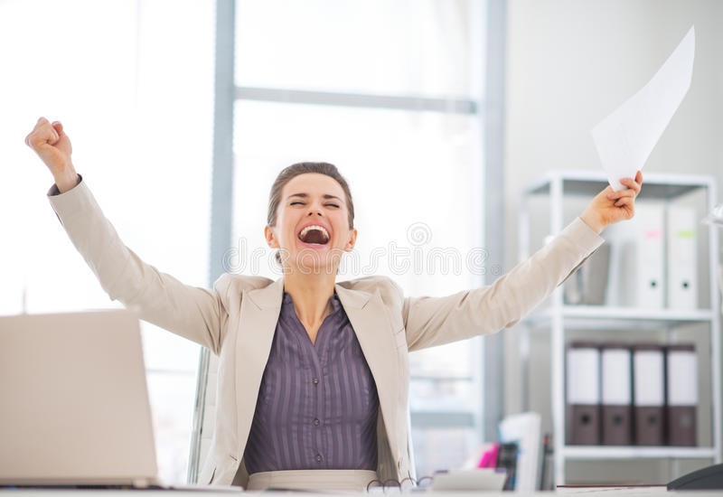 Happy business woman with document rejoicing stock image
