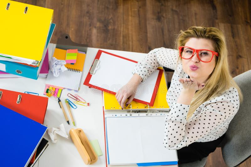 Happy business woman in office blow kiss stock photos