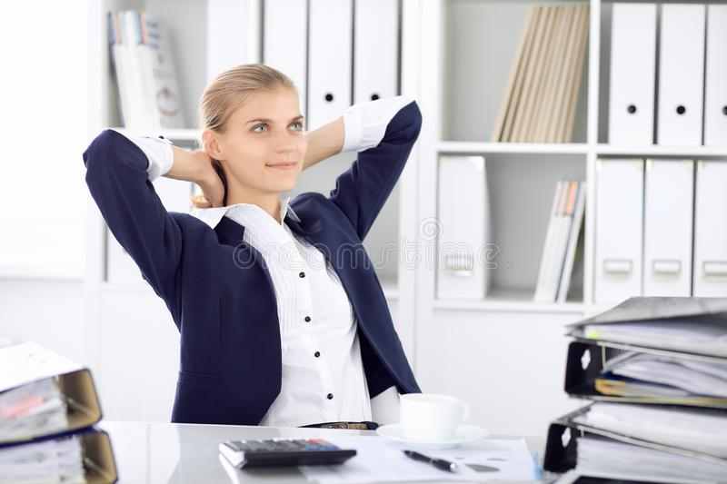 Happy business woman or female accountant having some minutes for time off and pleasure at working place. Audit and tax. Concepts in business stock images