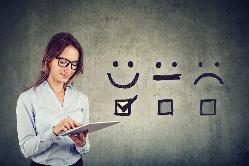 Happy business woman giving excellent rating for online satisfaction survey royalty free stock photo