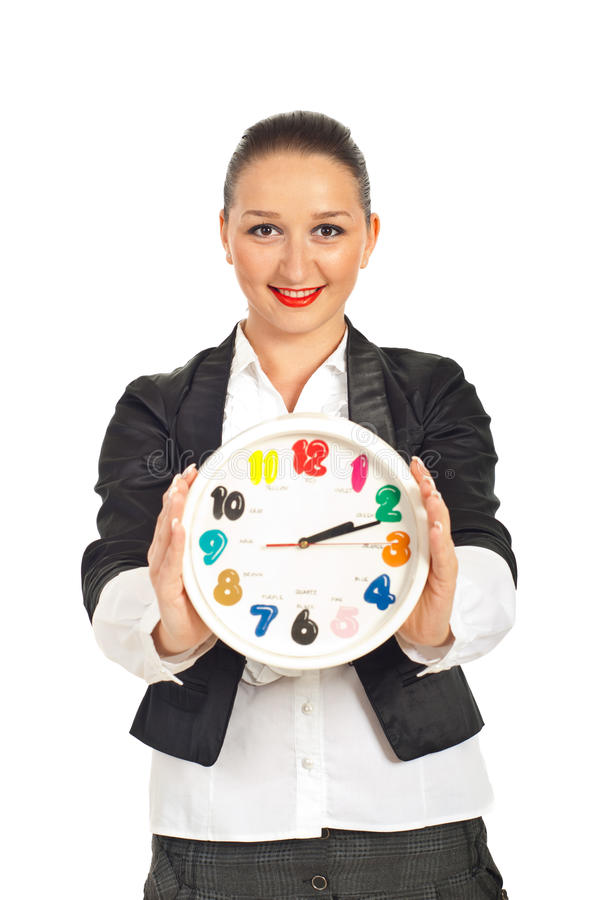 Happy business woman holding clock