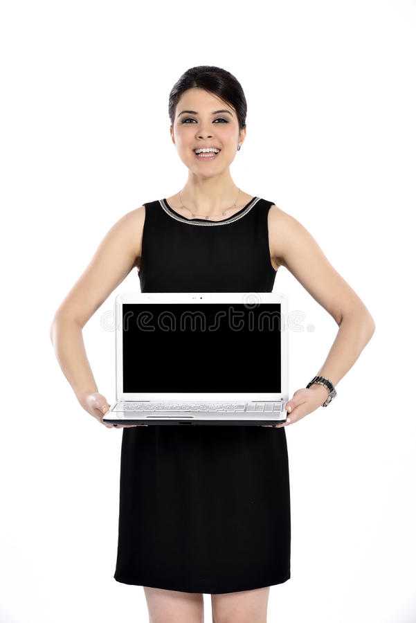 Happy business woman holding a laptop on white. Beautiful businesswoman isolated white background. Happy business woman holding a laptop stock photography