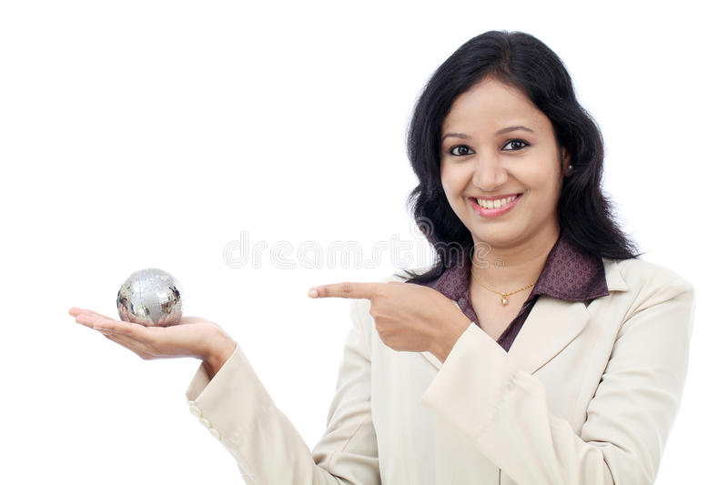 Happy business woman holding puzzle globe stock photos