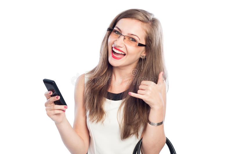 Happy business woman holding smartphone and showing call me sign stock photo