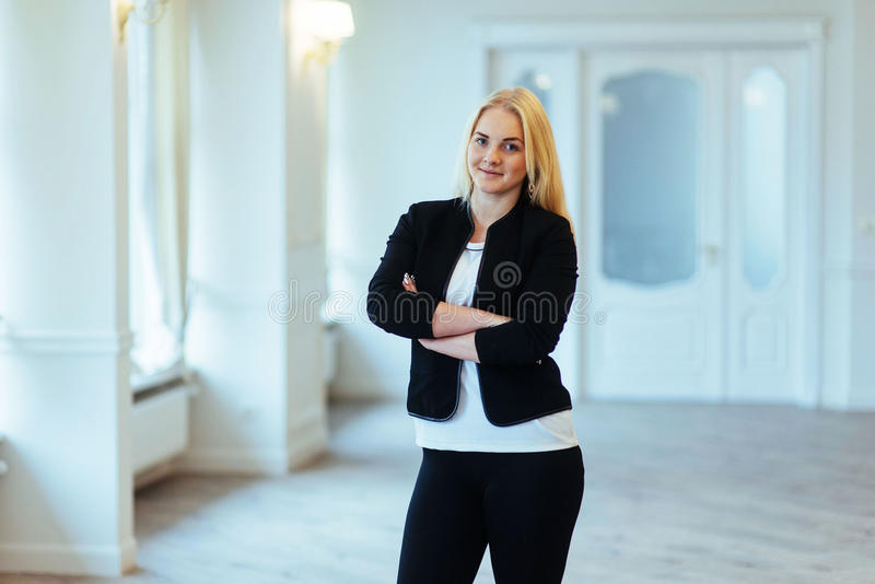 Happy business woman looking confident with modern building as b. Ackground stock image